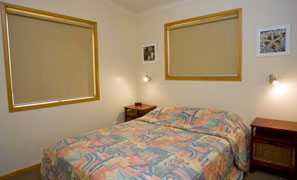 Master Bedroom in the Waterfront Executive Cabin Accommodation Joalah Holiday Park