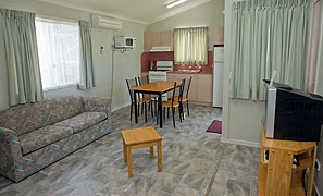 Loungeroom and Kitchen Standard Cabin Accommodation Joalah Holiday Park